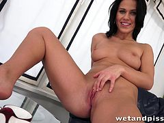 Get excited watching this brunette babe, with a nice ass and natural boobs, while she touches herself ardently in a solo model video.