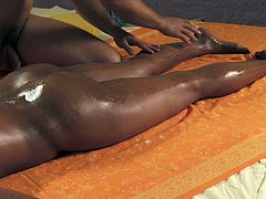Luscious ebony girl with tempting body is pleased with sensual massage at the parlor. Handsome masseur rubs her body with oil. He then puts his dick in her wet punani from behind. He pokes her slowly.