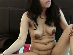 Naughty Indian girl feels horny and in need to psoe her nude forms to the cam in a sleazy solo show