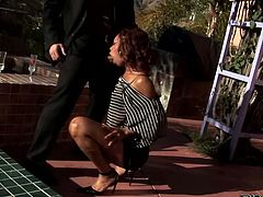 Red haired seductive hooker in stripped t-shirt posed on knees and pleased that thirsting man with hard deep throat on fresh air.Look at that steamy oral sex in Pinko HD sex video!