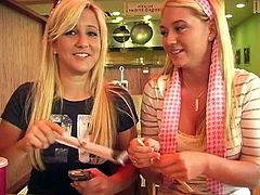 Two pleasurable blondes make some naughty things in a cafe