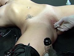 Dirty gals look quite appealing in leather costumes while fisting one another's tight vag on cam