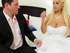 Effortlessly seductive blonde Bridgette B looks simply stunning in her wedding dress. This boobalicious bombshell knows that she is driving her fiance crazy so she makes him lick her sweet pussy.
