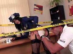 The slutty Madison Parker is wearing the uniform of the police officer. This nasty chick slurps on his penis and shows him just how nasty she can be.