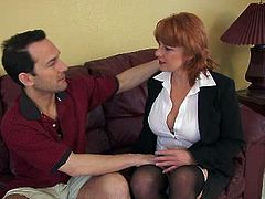 Naughty red haired mom takes off her clothes demonstrating her sexy body. She lets the guy lick her nipples and feel up her body all over. She then gives him head.