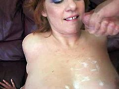 Redhead mommy with natural boobs gets massive tit cumshot