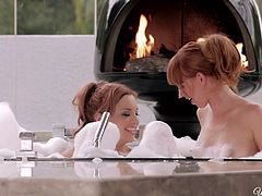 Sexy red haired babes Jayden Cole and Marie McCray take a bubbly bath together, get horny and start fingering and licking each other.