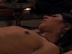 Delectable black haired babe with small tits Sahara Knite lies on big bed all naked while her passionate lover licks her tight hairy pussy and then makes love missionary style.