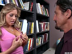 Samantha Saint and Tommy Gunn are getting naughty in an office. The girl gives a blowjob to Tommy and they bang in the missionary position and doggy style.