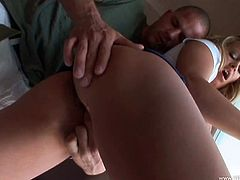 Make sure you take a look at Brandy Talore's amazingly big natural tits as she sucks on this guy's big cock before being fucked.