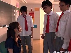 Lustful Japanese teacher wearing glasses is getting naughty with a few men indoors. She kneels in front of the dudes and sucks their pricks till they explode with cum.
