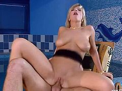 The salacious blonde whore with big and natural tits enjoys oral sex with her lover right before he shoves it deep inside of her.