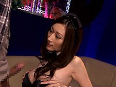 This hot Japanese slut is dressed up like a playboy bunny. She pulls her top down and sticks her man's dick between her bouncy boobs. She gets him off with a nice tit fucking. She sucks him off and loves the taste of his cock.