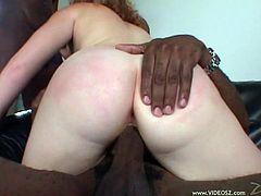 Salacious redhead chick Cherry Poppens is having fun with two black dudes in interracial threesome clip. Cherry pleases the guys with blowjobs and lets them drill her twat doggy style.