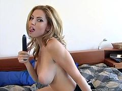 Enjoy this clip where a blonde babe, with huge jugs wearing a cute bra, touches herself and plays with a vibrator until she has an orgasm.
