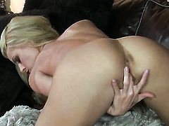 Randy Moore with big boobs and shaved snatch gets the pleasure from pussy stroking