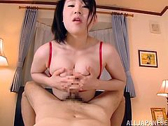 Lewd Japanese milf, wearing stockings, shows her big boobs to a guy and sits down on a bed in front of him. She rubs his dick with her hands and feet and moans sweetly.