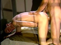 Two sexy gay studs are getting naughty in prison. One of the dudes pleases his buddy with a blowjob and then stands on all fours and gets his butt smashed.