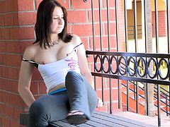 Veronika fingers her nice pussy sitting on a bench outdoors