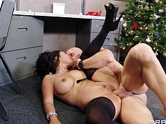 Watch this hardcore scene where the busty Asian babe Jessica Bangkok and one of her coworkers fuck hard in a Christmas party in the office.