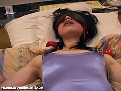 Checkout this cute Asian tied to the bed and blindfolded. She is in a tight body suit, she gets her tight hairy pussy fondled with a vibrator. Watch how she gets multiple orgasm while she moans and tries to scream. Enjoy!