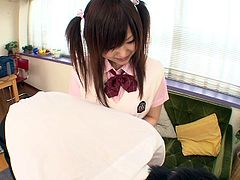 This schoolgirl makes her teacher get up on the table so she can milk the cum out of him with a handjob. He is so hard now so she treats him to a feetjob with her nylon covered soles. Will he blow his cum all over her feet?
