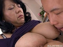 Busty Asian mom Emiko Ejima is having fun with a guy indoors. They pet each other and fuck in the cowgirl and the missionary positions.