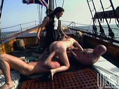 The times of mid century and Juli Ashton is on the board of a pirate ship! Those bandits are going to fuck her in a gangbang!