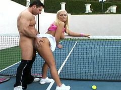 Her big boobs are shaking like crazy while a huge dong is strongly smashing her fine pussy on the tennis field