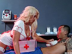 Have a look at this hardcore scene where nurse Alura Jenson ends up with her big tits covered by semen after being fucked by a patient.