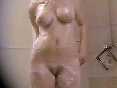 Sexy women are in the shower after an exhausting swimming training. Watch them rubbing their titties without having any fucking idea that they are on camera.