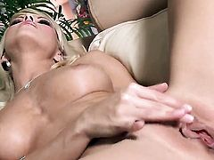 Jana Cova with hairless pussy with moist wet spot goes solo