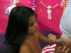 Sex appeal Asian floosie Cindy jerks off big cock standing on her knees. Then she spreads legs wide open and stimulates clit with vibrator.