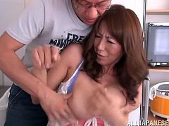 Mature Japanese woman cooks a dinner for a younger guy. She gets seduced after a meal. The guy licks her juicy boobs and fucks Shiori on a chair.