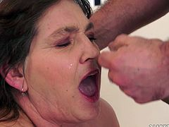 Get a load of this granny's big natural tits as this guy plays with them in this hardcore scene where she sucks his hard cock before being fucked.