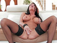 Jessica Jaymes takes off her lingerie before fingering herself