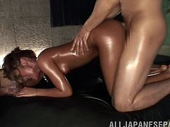 Gorgeous Japanese babe on her knees as they vibrate her oiled pussy showing her hot ass before they fuck her doggy style as she gives a blowjob