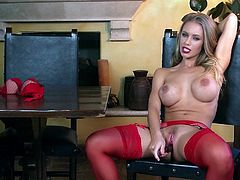 Watch the busty Nicole Aniston taking off her bra before masturbating with a dildo while still wearing stockings.