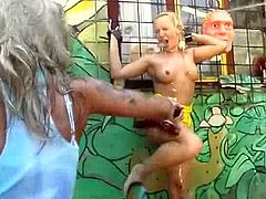 Paul forces a blonde to suck on his dick before he bounds her to a wall. Next, his other blonde slave contributes to getting her dirty. He washes them with a hose before fucking them.