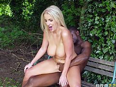 Gorgeous busty blonde Georgie Lyall is having fun with black stud Antonio Black outdoors. The bombshell pleases the guy with a blowjob and lets him drill her ivory pussy.
