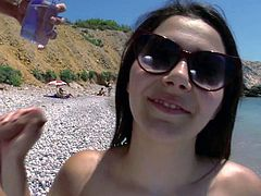 Curvy Italian porn diva Valentina Nappi shakes her big bubble ass and exposes her massive natural jugs on the beach. Then naked shameless honey sucks dudes big hard dick in public. She loves doing it by the sea.