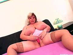 BBW June has a set of all natural boobies sure to make your mouth hit the floor. And don't let those innocent looks fool you. This voluptuous babe is one naughty BBW! Watch as she sedcues the camera with her huge tits. She starts playing with a huge dildo. First giving herself a titjob and later masturbates.