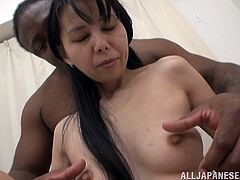 What are you waiting for? Watch this Asian MILF, with long hair and natural boobs, while she has interracial sex after serving a handjob.