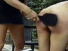 This cruel mature milf is one hard mistress.See how she uses big paddle for spanking that poor babes tight round ass.She spanks her so hard that poor teen cries in pain.