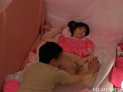 A cute Japanese girl in fancy dress gets fucked in her bald pussy