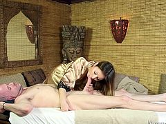 This masseuse knows her way around a man's body. She rubs down this guy and before long he is sporting a massive erection. There is only one way to release his stress and that's sucking his cock. She works his penis so well with her skill mouth and pleases the head, shaft and base.