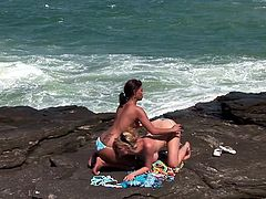 Beautiful girls Tarra White and Aneta Keys are getting naughty on a rocky shore. The lesbians lick and finger each other's pussies and enjoy it a lot.