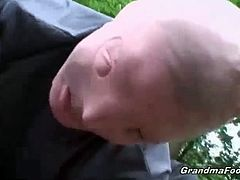 Two evil masked dudes got the opportunity to grab blonde grandma being alone in the forest. They remove her outfit forcing their huge dick inside her shaved clit.