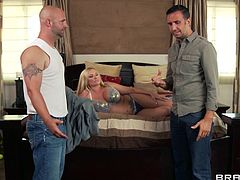 Busty blonde Briana Banks is trying hard to please Keiran Lee. She gives a blowjob to the man and licks his balls, then they fuck in the reverse cowgirl position.