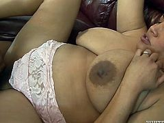 Curvaceous brunette whore with huge boobs is nailed bad in a missionary position. Two horny stud give her no mercy so she moans wild.